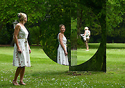 © Licensed to London News Pictures. 24/05/2012. Waddesdon, UK. Kathryn Hobbs poses with a Mirror Sculpture by Jeppe Hein in the grounds of the Manor. People enjoy the warm weather amongst an exhibition of contemporary sculpture at Waddesdon Manor, Buckinghamshire, today 24th May 2012. The exhibition is being held by Christie's as part of a private sale. Photo credit : Stephen Simpson/LNP