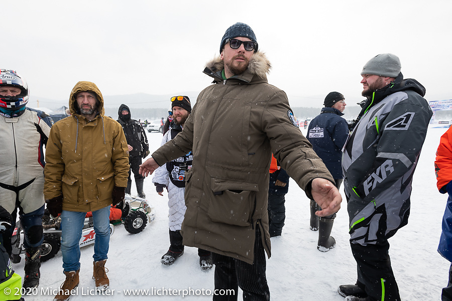 Event promoter Dmitry Khitrov talks with racers at the Baikal Mile Ice Speed Festival. Maksimiha, Siberia, Russia. Thursday, February 27, 2020. Photography ©2020 Michael Lichter.