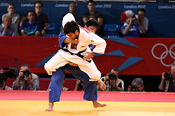 Mansur Isaev of Russia (Blue) takes on Riki Nakaya of Japan (White) during the men's -73KG Judo final held at the Excel North Arena in London as part of the London 2012 Olympics on the 30th July 2012.Photo by Ron Gaunt/SPORTZPICS