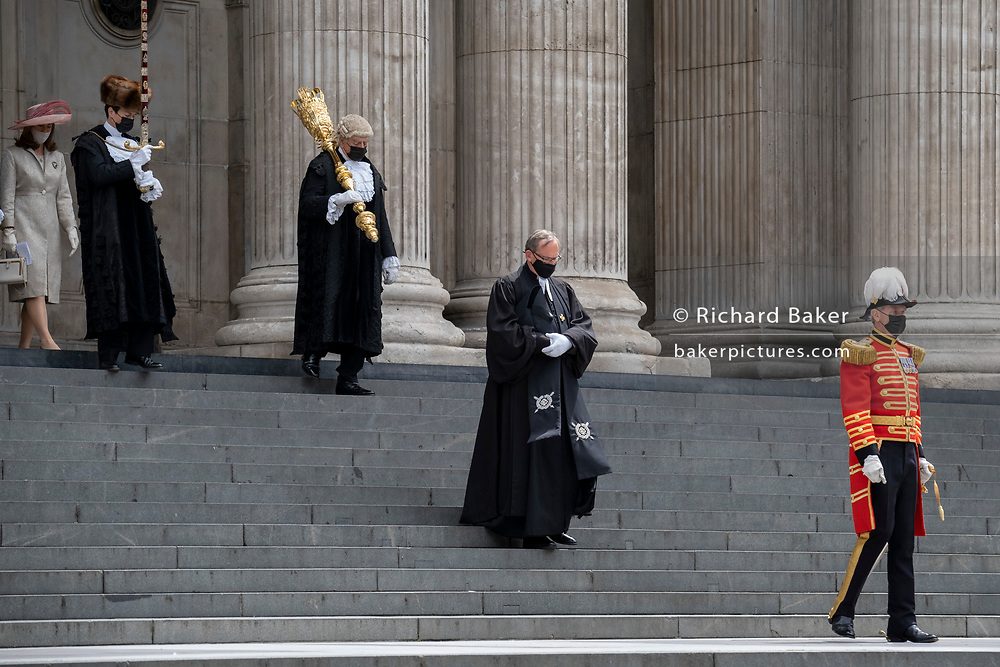 Official dignitaries descend the steps of St Paul's Cathedral after the private 'The Lord Mayor's Service of Reconciliation And Hope' function, on 22nd June 2021, in London, England.