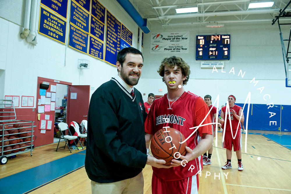 Belmont's Sean Newman receives the game ball from Belmont head coach Scott Currier after scoring his 1000th career point during Tuesday's game at Franklin.  (Alan MacRae/for the Citizen)