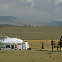 MONGOLIA. A herding family outside their ger (yurt) in Darhad Valley.