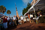 People stroll along the organic local produce farmers market in Marion Square in Charleston, South Carolina with St. Mathews Lutheran Church in the background (photo by Charleston SC photographer Richard Ellis)