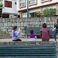 Girls spending time playing volleyball and reading newspapers in Aguas Calientes.