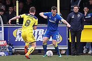 AFC Wimbledon defender Jon Meades (3) dribbling and taking on Oxford United midfielder Ryan Ledson (8) during the EFL Sky Bet League 1 match between AFC Wimbledon and Oxford United at the Cherry Red Records Stadium, Kingston, England on 10 March 2018. Picture by Matthew Redman.