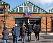 McArthur Glen designer outlet west entrance into former railway works, Swindon, Wiltshire, England, UK