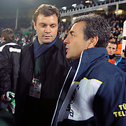 Bursaspor's coach Ertugrul Saglam (L) and Fenerbahce's coach Aykut Kocaman (R) during their Turkish soccer super league match Bursaspor between Fenerbahce at Ataturk Stadium in Bursa Turkey on Monday, 12 December 2010. Photo by TURKPIX