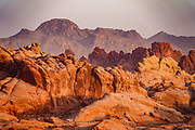 View from Rainbow Vista, in Valley of Fire State Park, Moapa Valley, Nevada, USA. Starting more than 150 million years ago, great shifting sand dunes during the age of dinosaurs were compressed, uplifting, faulted, and eroded to form the park's fiery red sandstone formations.