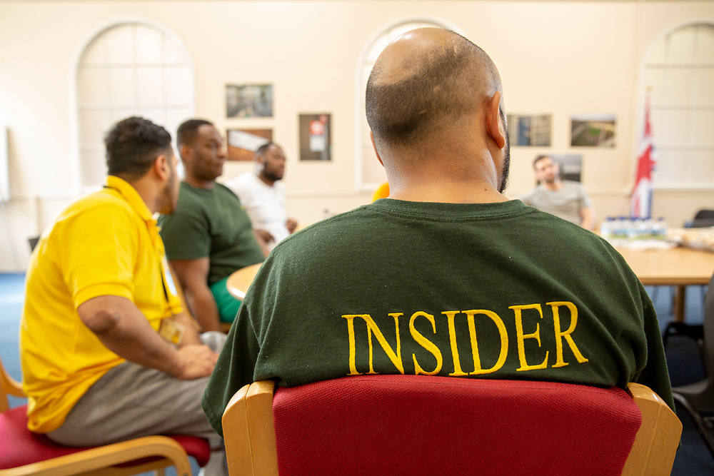 Prisoners attend an education meeting in Her Majesty's Prison Pentonville, London, United Kingdom.  They are part of the Doing Time Programme, one male wears the green Insider t-shirt which shows that he is a trusted inmate who offers support to other prisoners. (Photo by Andy Aitchison)