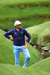 April 7, 2018 - Augusta, GA, USA - Rickie Fowler hit into the creek on the 13th hole during the third round of the Masters Tournament on Saturday, April 7, 2018, at Augusta National Golf Club in Augusta, Ga. (Credit Image: © Curtis Compton/TNS via ZUMA Wire)