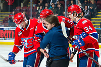 KELOWNA, BC - JANUARY 31: Adam Beckman #34 and Michael King #19 help Jordan Chudley #5 of the Spokane Chiefs up off the ice with the assistance of athletic therapist Joe Hurley and linesman Dustin Minty after a fight with Tyson Feist #25 of the Kelowna Rockets during first period at Prospera Place on January 31, 2020 in Kelowna, Canada. (Photo by Marissa Baecker/Shoot the Breeze)