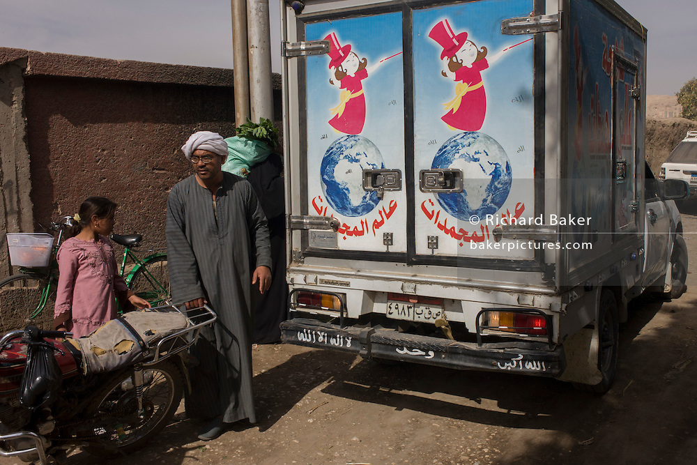 The rear of a van as it passes through the weekly market at Qurna, a village on the West Bank of Luxor, Nile Valley, Egypt.