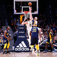03 April 2018: Denver Nuggets center Nikola Jokic (15) goes for the floater shot over Indiana Pacers center Domantas Sabonis (11) during the Denver Nuggets 107-104 victory over the Indiana Pacers, at the Pepsi Center, Denver, Colorado, USA.
