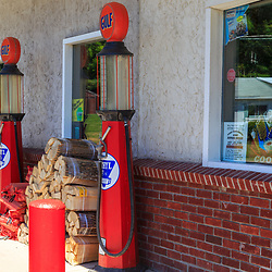 Troy, PA - July 26, 2016: Vintage glass bowl gas pumps outside B&S convenience store, a modernized gas station on Route 6 west of Troy.