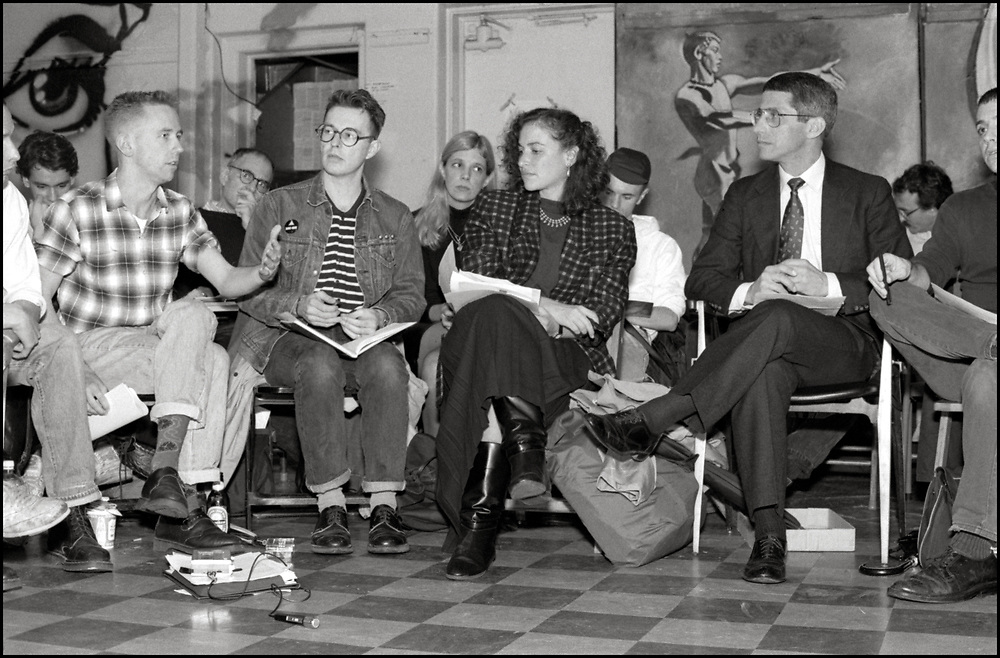 On October 19, 1989 ACT UP NY hosted an historic three hour meeting with Anthony Fauci, the then Director of the National Institute of Allergy and Infectious Diseases (NIAID), at The Gay and Lesbian Community Center (The Center) in New York City. The audience was allowed to ask Fauci questions related to HIV disease progression, treatment, community-based drug trials and allegations of homophobia in relation to Community Research Initiative funding. <br /> <br /> Front row (L-R): Mark Harrington, Simon Watney, Peggy Hamburg, Anthony Fauci and Richard Elovich (cut off)<br /> <br /> Back row (L-R): Spencer Cox, Larry Kramer, Dr. Suzanne Phillips, Keith Alcorn, Steve Rosenbush
