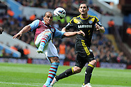 Aston Villa's Gabriel Agbonlahor is challenged by Chelsea's Frank Lampard. Barclays Premier League, Aston Villa v Chelsea at Villa Park in Birmingham on Saturday 11th May 2013. pic by Andrew Orchard,  Andrew Orchard sports photography,