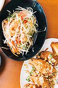 Papaya salad and deep fried chicken wing marinated with fish sauce at Som Tum So Lao, Chiang Mai