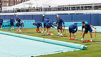 Tennis - 2019 Queen's Club Fever-Tree Championships - Day Two, Tuesday<br /> <br /> Queens Club ground staff drag across the covers on court 7 ahead of the scheduled warm up from Andy Murray at Queens Club.<br />  <br /> COLORSPORT/DANIEL BEARHAM
