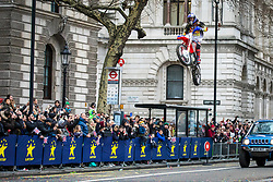 © Licensed to London News Pictures. 01/01/2018. London, UK. A stuntman performs a motorbike jump on Whitehall at the New Year's Day Parade in Central London. Photo credit: Rob Pinney/LNP