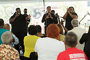 Singer Jarell Smalls, left, leads the audience in praise songs during a memorial service for the victims of the Mother Emanuel African Methodist Episcopal Church shooting on the 2nd anniversary June 17, 2017 in Charleston, South Carolina. Nine members of the historic African-American church were gunned down by a white supremacist during bible study on June 17, 2015.