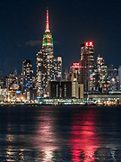 The New Yorker, A Wyndham Hotel, an Art Deco-inspired hotel, and The Empire State Building define the skyline of New York City.