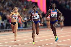 Great Britain's Daryll Neita (silver) and USA's Tori Bowie (gold) in the Women's 4x100m Relay Final during day nine of the 2017 IAAF World Championships at the London Stadium.