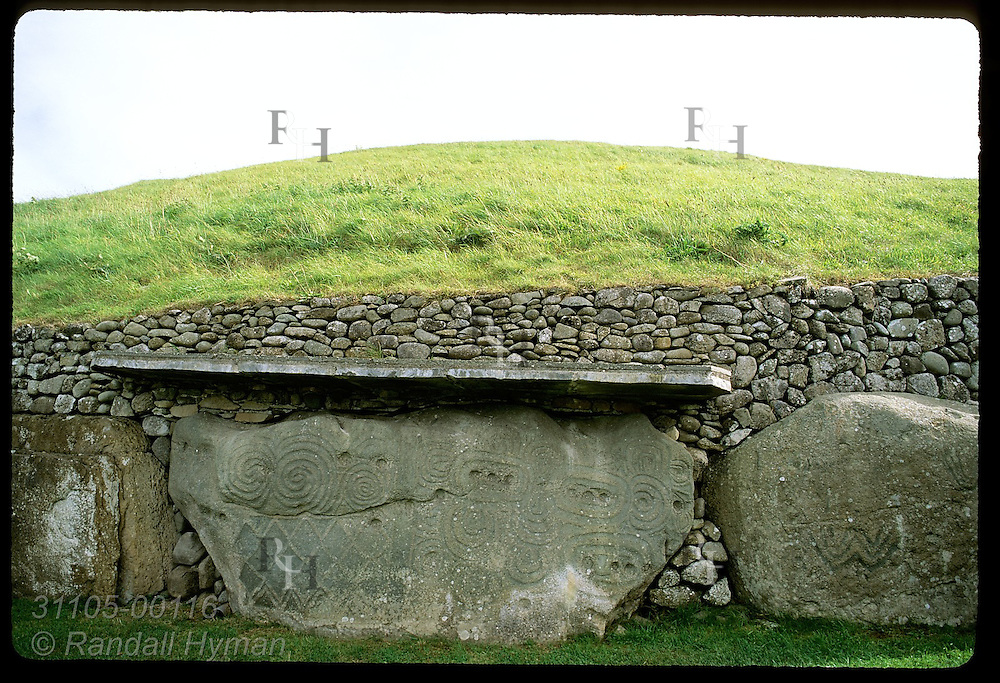 Ornamented kerbstone, one of 97 at Newgrange burial mound, a Neolithic (3200 BC) passage grave in the Boyne Valley; Ireland.