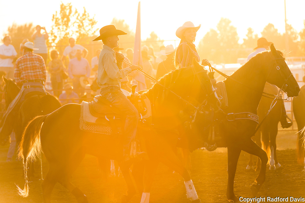 Sunset, and the rodeo begins. Dexter rides behind a girl, talking and laughing. It's a serene moment, and it's obvious they love what they do.