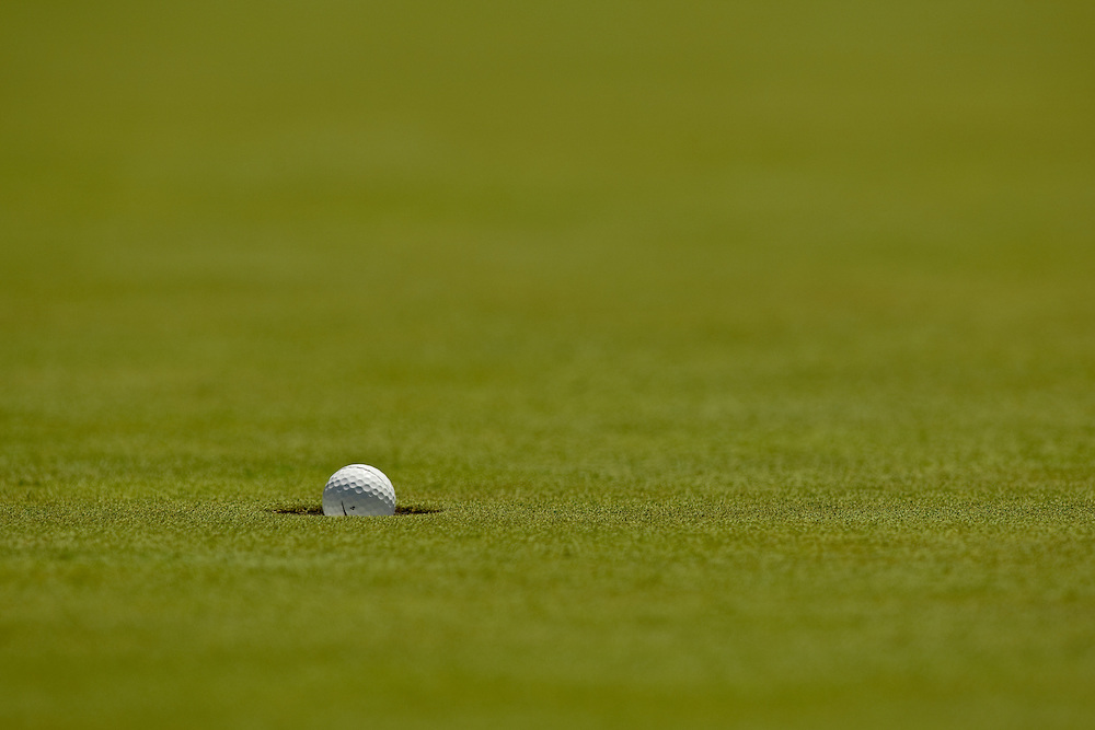 NEWTOWN SQUARE, PA - JULY 1: Tiger Woods' golf ball falls in the hole during the first round of the AT&T National Classic at Aronimink Golf Club on July 1, 2010 in Newtown Square, Pennsylvania. (Photo by Darren Carroll) *** Local Caption *** Tiger Woods