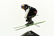 SHOT 1/25/2004 - Tanner Hall of Kalispell, Mont. goes up and over a kink in one of the rails on the Ski Slopestyle course at Winter X Games VIII at Buttermilk Mountain in Aspen on Sunday. Hall walked away with a gold medal in the event, it's his third consecutive Winter X Games gold medal. The five day long event that started Friday and continues through Tuesday and features more than 250 of the top winter sports athletes from across the globe competing in Moto X, Ski, Snowboard and Snowmobile. For the first time, the Winter X Games will feature first-time nighttime events to go along with the live telecasts. Events are free to attend. Tanner Hall (born October 26, 1983) of Kalispell, Montana is a freeskier. In an attempt at his fourth straight Winter X Games gold in skier slopestyle he was upset by Charles Gagnier..In March of 2005, Hall was severely injured in an attempt to switch 900 over the infamous 136 foot Chad's Gap, coming up short on the high side of the landing and fracturing both ankles and heel bones..(Photo by Marc Piscotty/ © 2004)