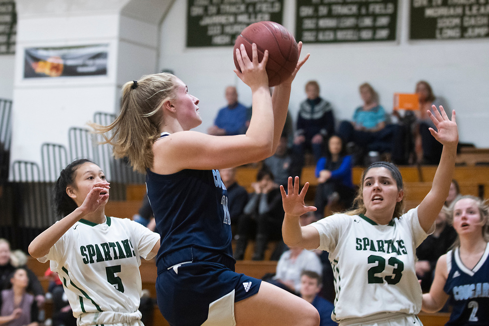 MMU's Meadow Worthley (20) leaps for a layup during the girls basketball game between the Mount Mansfield Cougars and the Winooski Spartans at Winooski High School on Friday night February 14, 2020 in Winooski, Vermont.(BRIAN JENKINS/for the FREE PRESS)