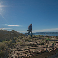 A hker walks past eroded rock features overlooking Fort Peck Reservoir in Charles M. Russell National Wildlife Reserve, Montana.