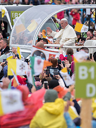 © Licensed to London News Pictures. 26/08/2018. Dublin, Ireland. Pope Francis arrives in the Phoenix Park Dublin in his popemobile. He said mass to an estimated hundred thousand people. Pope Francis is the 266th Catholic Pope and current sovereign of the Vatican. Photo credit: Barry Cronin/LNP