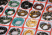 Bracelets for sale on souvenir stall in Ping An, Guilin, China