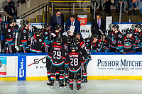KELOWNA, CANADA - NOVEMBER 23: Assistant coaches Travis Crickard and Kris Mallette look on as head coach Adam Foote goes over a play on the bench against the Victoria Royals  on November 23, 2018 at Prospera Place in Kelowna, British Columbia, Canada.  (Photo by Marissa Baecker/Shoot the Breeze)