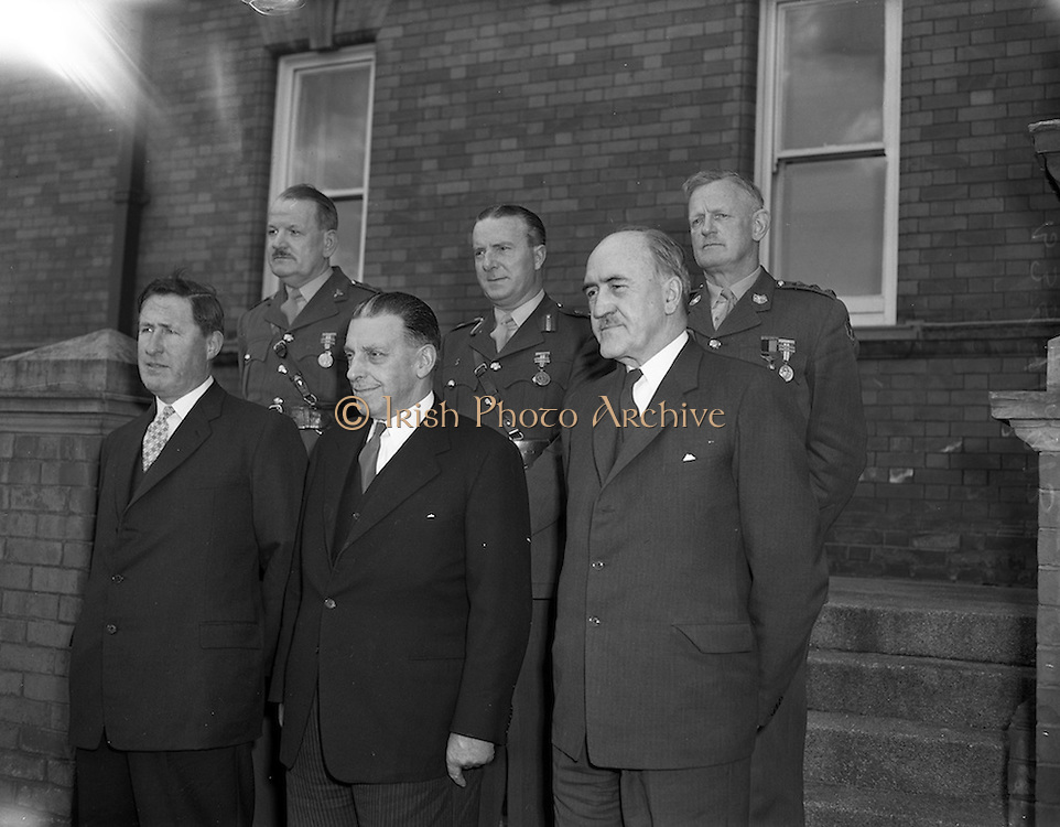 11/04/1960<br /> 04/11/1960<br /> 11 April 1960<br /> The United Nations Medal was presented to 47 Officers of the Irish Army who served in U.N.O. forces in 1959/60,by the Taoiseach Sean Lemass at a ceremony at Collin's Barracks, Dublin. Picture shows the Defence Council: (l-r) Front Row: Kevin Boland T.D. Minister of Defence; Sean Lemass, An Taoiseach and Frank Aiken, Minster of External Affairs. Back Row: Colonel P.J. Hally, Adjutant - General; Major - General Sean McKeown, Chief of Staff and Colonel Sean Collins Powell, Quartermaster General, DFA,