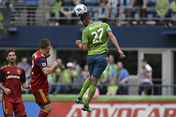 May 26, 2018 - Seattle, Washington, U.S - MLS Soccer 2018: The Sounders LAMAR NEAGLE (27) heads the ball away from the RSL defense as Real Salt Lake visits the Seattle Sounders in a MLS match at Century Link Field in Seattle, WA. RSL won the match 1-0. (Credit Image: © Jeff Halstead via ZUMA Wire)