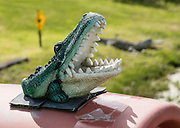 Crocodile sculpture on a mailbox. Freeland, Whidbey Island, Washington, USA.