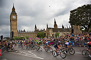 London, UK. Monday 7th July 2014. Tour de France passes the Houses of Parliament and Big Ben, whilst travelling through Westminster at the end of the British stage finishing in London.