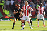 Stoke city's  Charlie Adam and Liverpool's Trent Alexander-Arnold in action.  Premier league match, Stoke City v Liverpool at the Bet365 Stadium in Stoke on Trent, Staffs on Saturday 8th April 2017.<br /> pic by Bradley Collyer, Andrew Orchard sports photography.