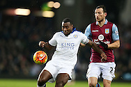 Wes Morgan of  Leicester city (l) shields the ball from Libor Kosak of Aston Villa. .Barclays Premier league match, Aston Villa v Leicester city at Villa Park in Birmingham, The Midlands on Saturday 16th January 2016.<br /> pic by Andrew Orchard, Andrew Orchard sports photography.