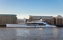 © Licensed to London News Pictures. 04/12/2019. London, UK. The tender boat travels in front of Dallas Cowboys owner and billionnaire, Jerry Jones's luxury 358 feet (109 meters) superyacht, Bravo Eugenia, which is seen moored at Butlers Wharf, near Tower Bridge on the River Thames after arriving in the capital late yesterday afternoon. The $225 million yacht which was built in 2018 is reported to be named after Jerry Jones's wife, Eugenia and have multiple luxuries onboard including two helipads, a fitness centre and sauna, and is capable of sleeping up to 14 people who are taken care of by a 30-person crew. Photo credit: Vickie Flores/LNP