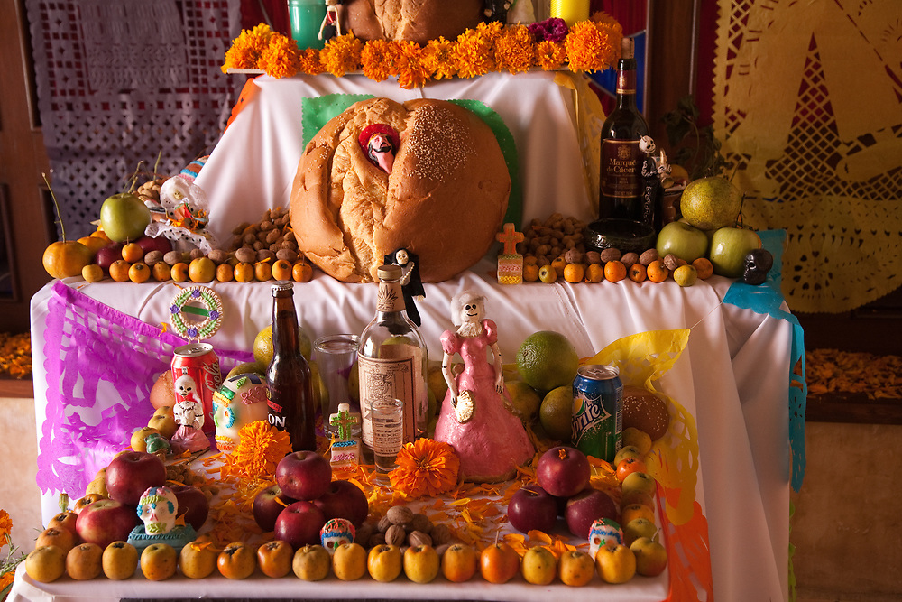 North America, Mexico, Oaxaca Province, Oaxaca,  altar (ofrenda) of food, marigolds and candles for Day of the Dead (Dias de los Muertos) celebration