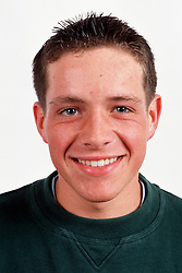 Portrait of teenage boy with short hair smiling,