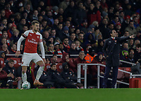 Football - 2018 / 2019 EFL Carabao (League) Cup - Fourth Round: Arsenal vs. Blackpool<br /> <br /> Aaron Ramsey (Arsenal FC) as Unai Emery, manager of Arsenal FC, points in the background at The Emirates.<br /> <br /> COLORSPORT/DANIEL BEARHAM