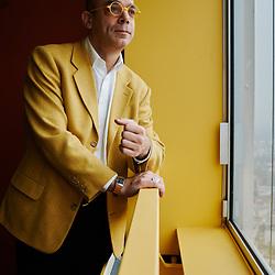Fabrice Midal, posing in his apartment. He's the founder of the Ecole occidentale de meditation (Occidental School of Meditation). Paris La Defense, France. January 26, 2020.<br /> Fabrice Midal, prenant la pose dans son appartement. Il est le fondateur de l'Ecole occidentale de meditation. Paris La Defense, France. 26 janvier 2020.