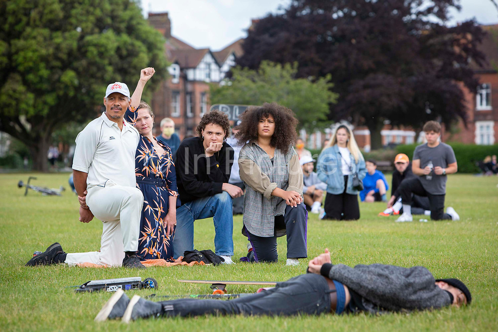 Adam and Jessica Hynes and family join residents of Folkestone gathered to Take the Knee at Radnor Park for a socially distanced show of solidarity in memory of George Floyd, the man recently murdered by Police in Minneapolis, United States on Sunday the 7th of June 2020 in Folkestone, United Kingdom. Home made banners with the slogans Black Lives Matter, Be Anti Racist, All Equal, End Racism and Always Challenge Racism could be seen.