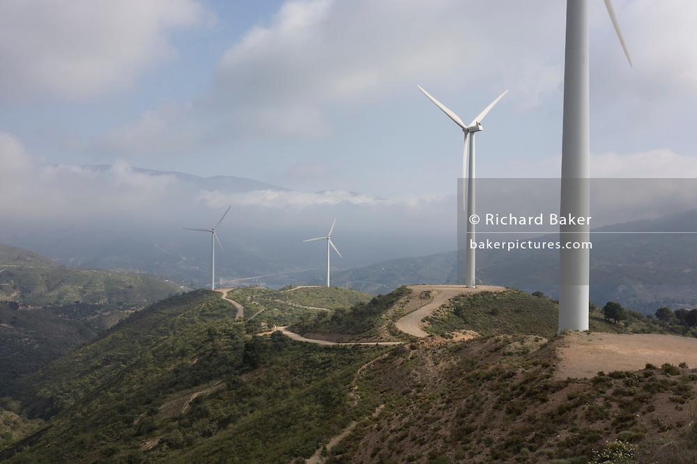 Windfarm turbine blades on hilltop of Sierra Nevada foothills.