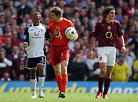 Jens Lehman and Robert Pires of Arsneal complain to Edgar Davids of Tottenham Hotspur after he played on while Emmanuel Eboue was injured.