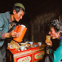 In a traditional ritual, a Tibetan offers a trekker barley beer (chang.)